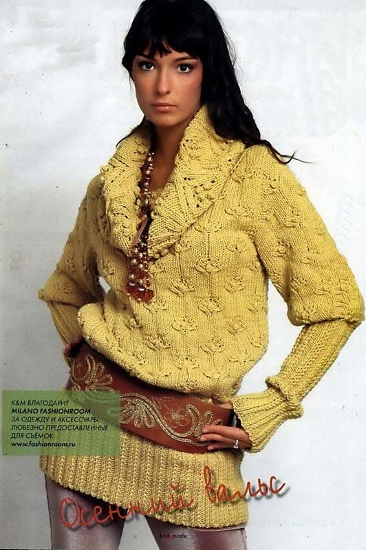 Вязаный женский пуловер с широкой резинкой.