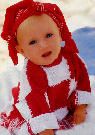 Вязаный детский свитер с бахромой